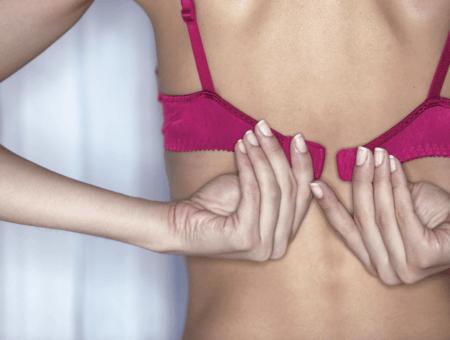 Woman buckling a bra