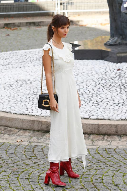 Emrata in a white dress at pfw