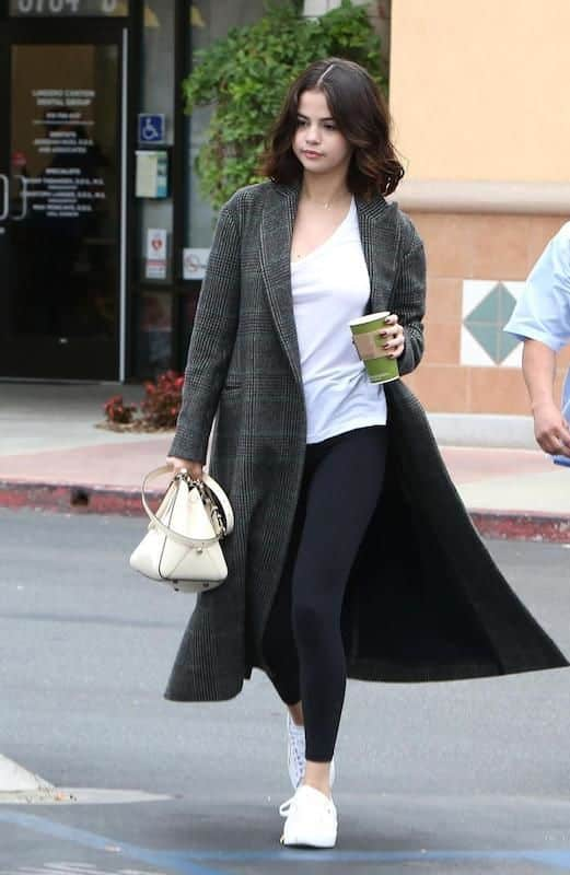 Selena gomez in a long coat