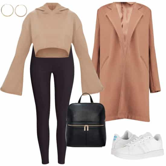 Sarah Hyland Outfit: beige cropped hoodie sweatshirt, a camel colored mid-length coat, black high rise leggings, gold hoop earrings, a black faux leather backpack, and white low-top sneakers