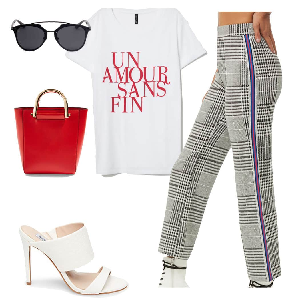 Jamie Chung Outfit: white and red graphic print t-shirt, plaid side stripe pants, black brow bar sunglasses, red structured top-handle bag, and white double strap stiletto sandals