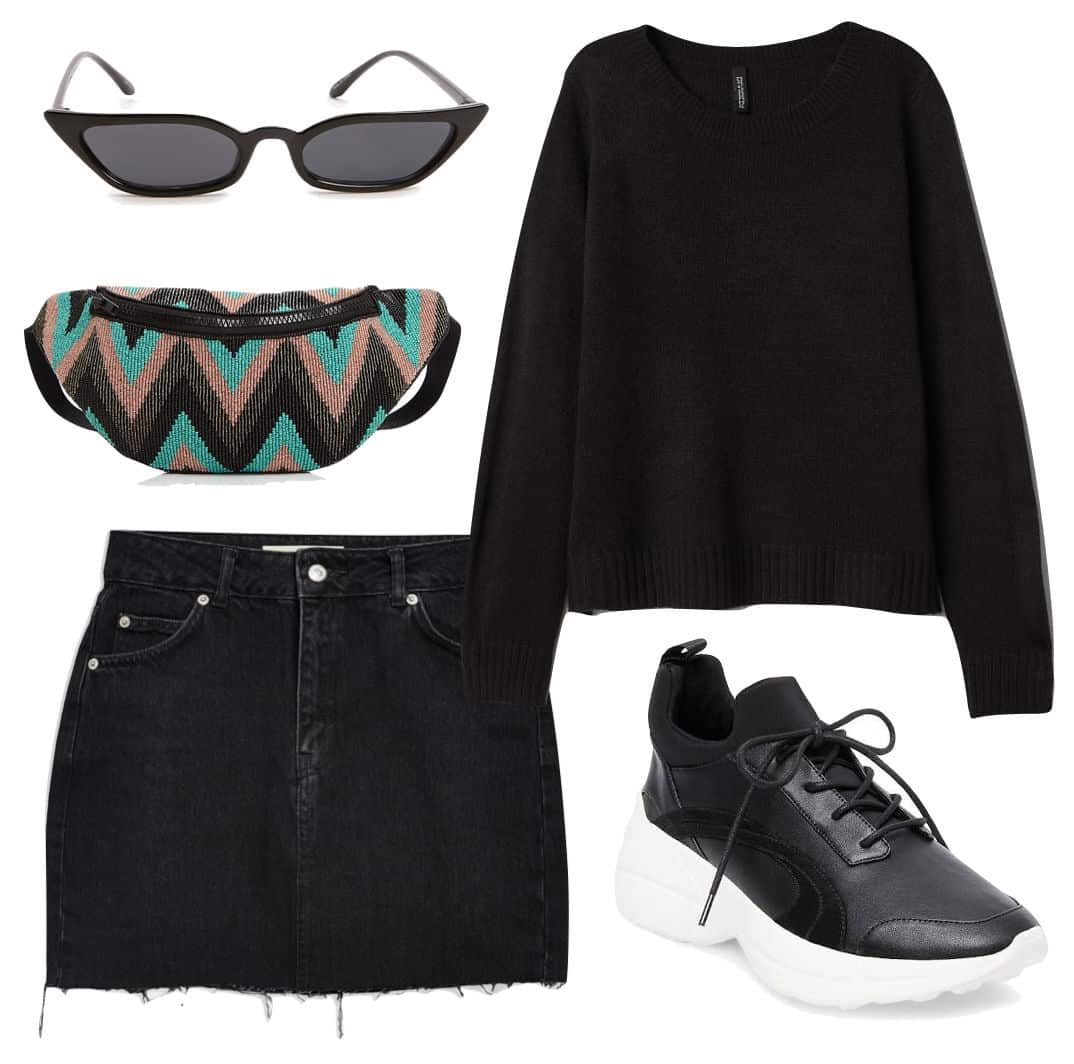 Ashley Tisdale Outfit: black crew neck sweater, black denim mini skirt, black chunky sneakers, a printed fanny pack bag, and angular cat eye sunglasses