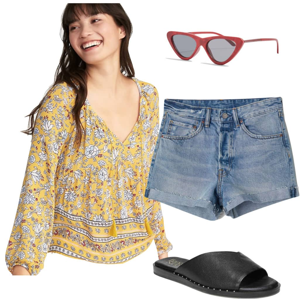 Emma Roberts Outfit: yellow floral print blouse, mom fit denim shorts, red cat-eye sunglasses, black asymmetrical flat slide sandals