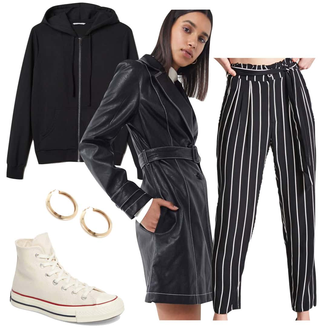 Kaia Gerber Outfit: black hoodie, black and white striped pants, gold chunky hoops, black faux leather trench coat, off white Converse high tops