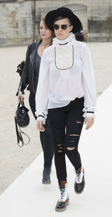 Cara Delevingne white high neck blouse and ripped jeans