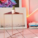 Simple bronze triangle nightstand from Urban Outfitters.