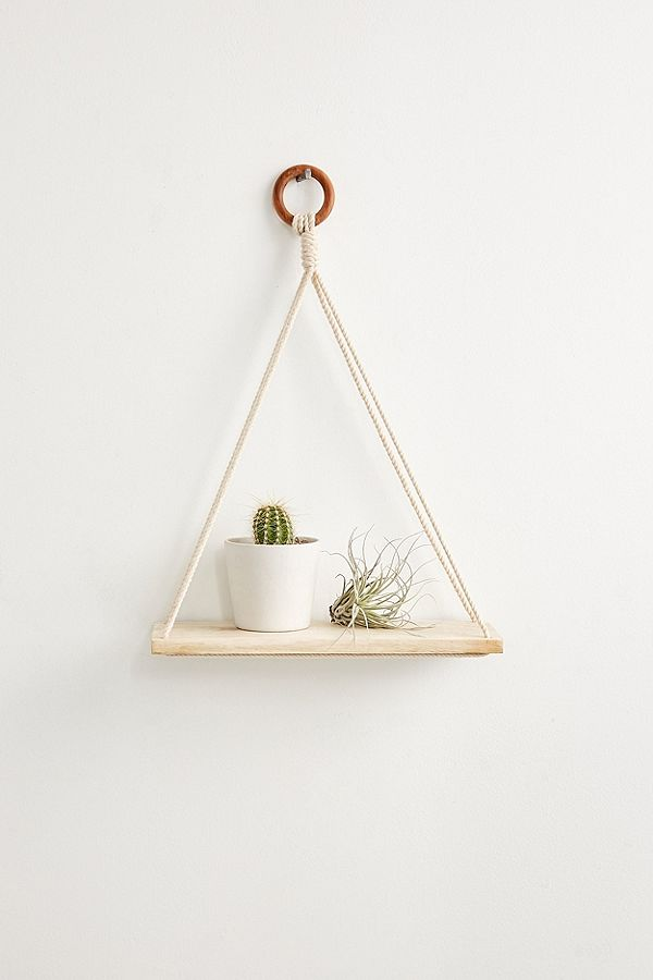 Macrame and wood simple wall shelf from Urban Outfitters.