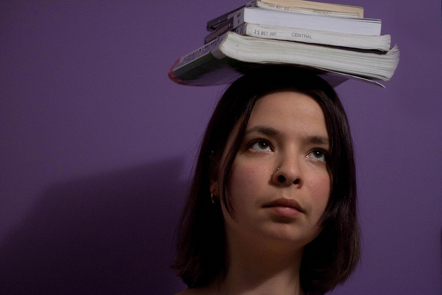 Girl with books on her head