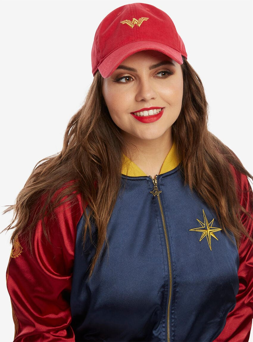 Red distressed baseball cap with embroidered Wonder Woman logo on the front. The brim is curved and the back strap is adjustable.