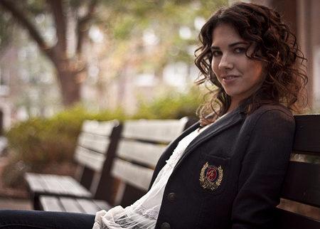 Girl in blazer on bench