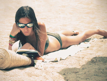 girl laying out on beach