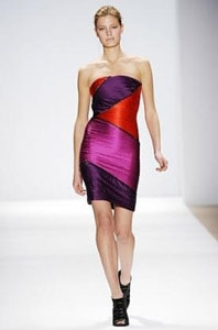 A bright, colorful purple colorblock dress on the Carlos Miele runway