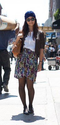 A street style fashionista wearing the turban trend