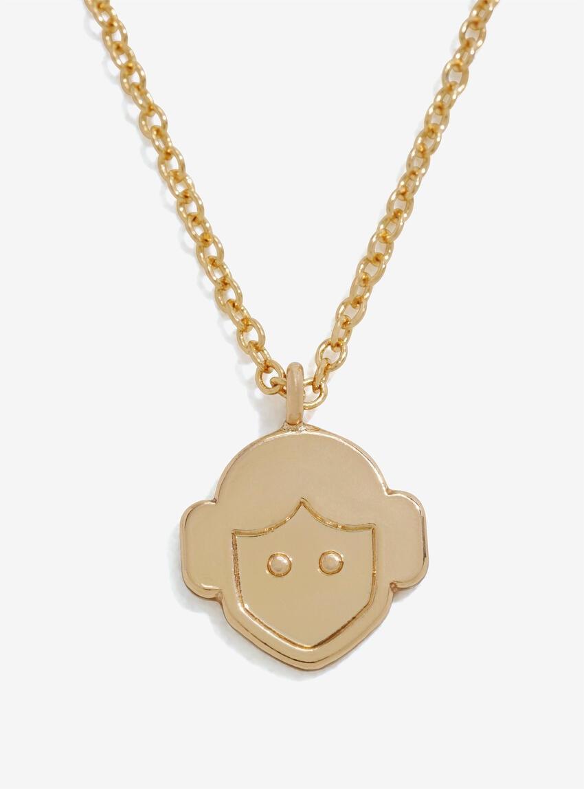 Metal gold tone necklace featuring cartoon Princess Leia head.