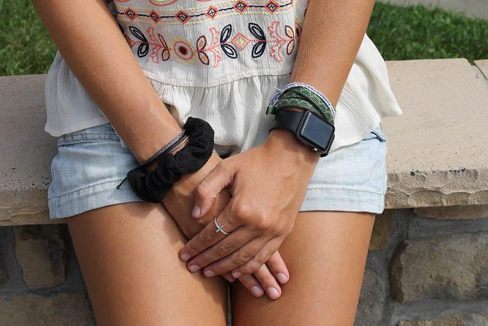 Ashton rocks lots of wrist candy at WVU, including a scrunchie, Pura Vida bracelets, and an Apple Watch