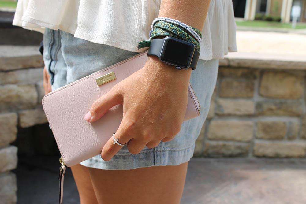 Ashton carries a Kate Spade wallet at WVU