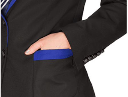 Close-up of woman's hand in pocket of Ravenclaw blazer