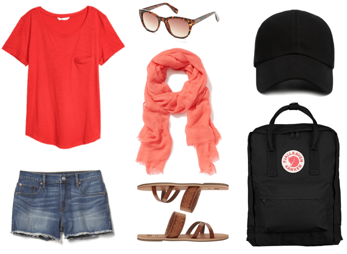 """Ask CF: What Should I Pack For My Job as a Camp Counsellor?"" Outfit #4 featuring bright red u-neck t-shirt with left chest pocket and rounded hem, medium-wash denim cut-off shorts with frayed hem, brown tortoise wayfarer sunglasses with brown lenses, coral scarf with fringe, cognac-brown strappy sandals with decorative strap, black baseball cap, black backpack with red-and-white Fjallraven logo"
