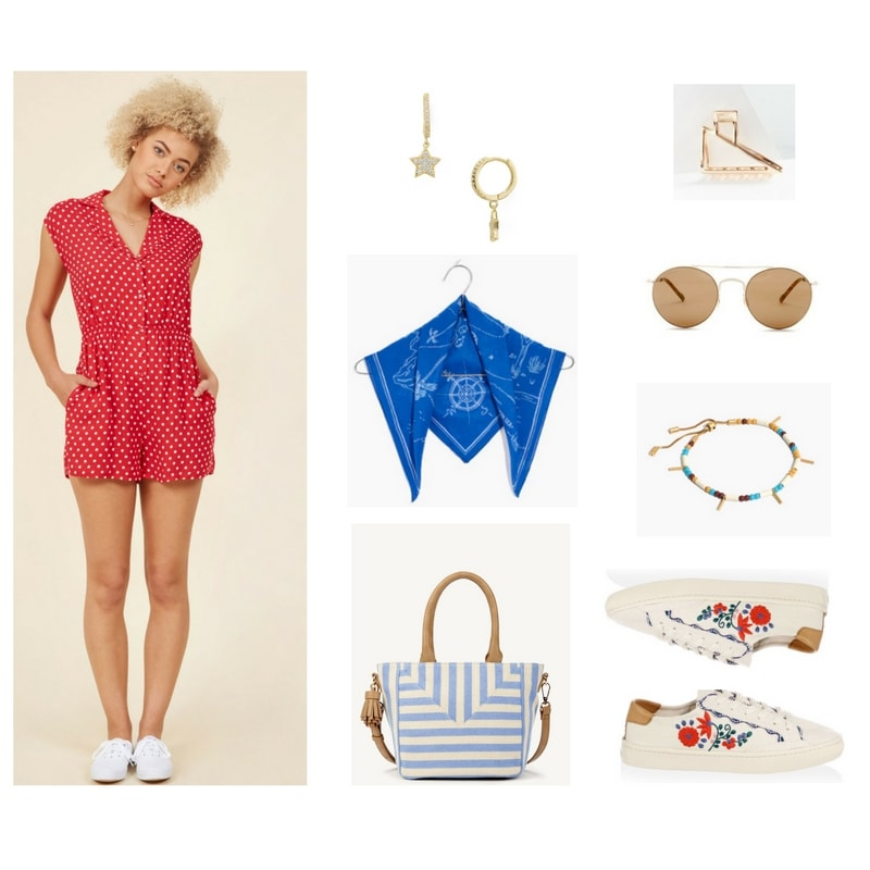 Red short-sleeved button-up romper with collar, white polka dots, and side pockets, gold huggie hoop earrings with small dangling stars with pavé clear stones, bright blue bandana with white nautical design, light blue-and-white striped satchel bag with faux-leather beige top-handles, cross-body strap, and fringe detail; gold metal claw clip, round gold aviator sunglasses with medium-brown lenses and tortoise-patterned ear pieces, white, turquoise, muted yellow, and brown beaded adjustable gold bracelet with gold bar beads; blush-pink sneakers with red, blue, green, and pale pink floral embroidery sneakers and tan detail at back, as well as red, blue, and green scalloped detail at sides near laces