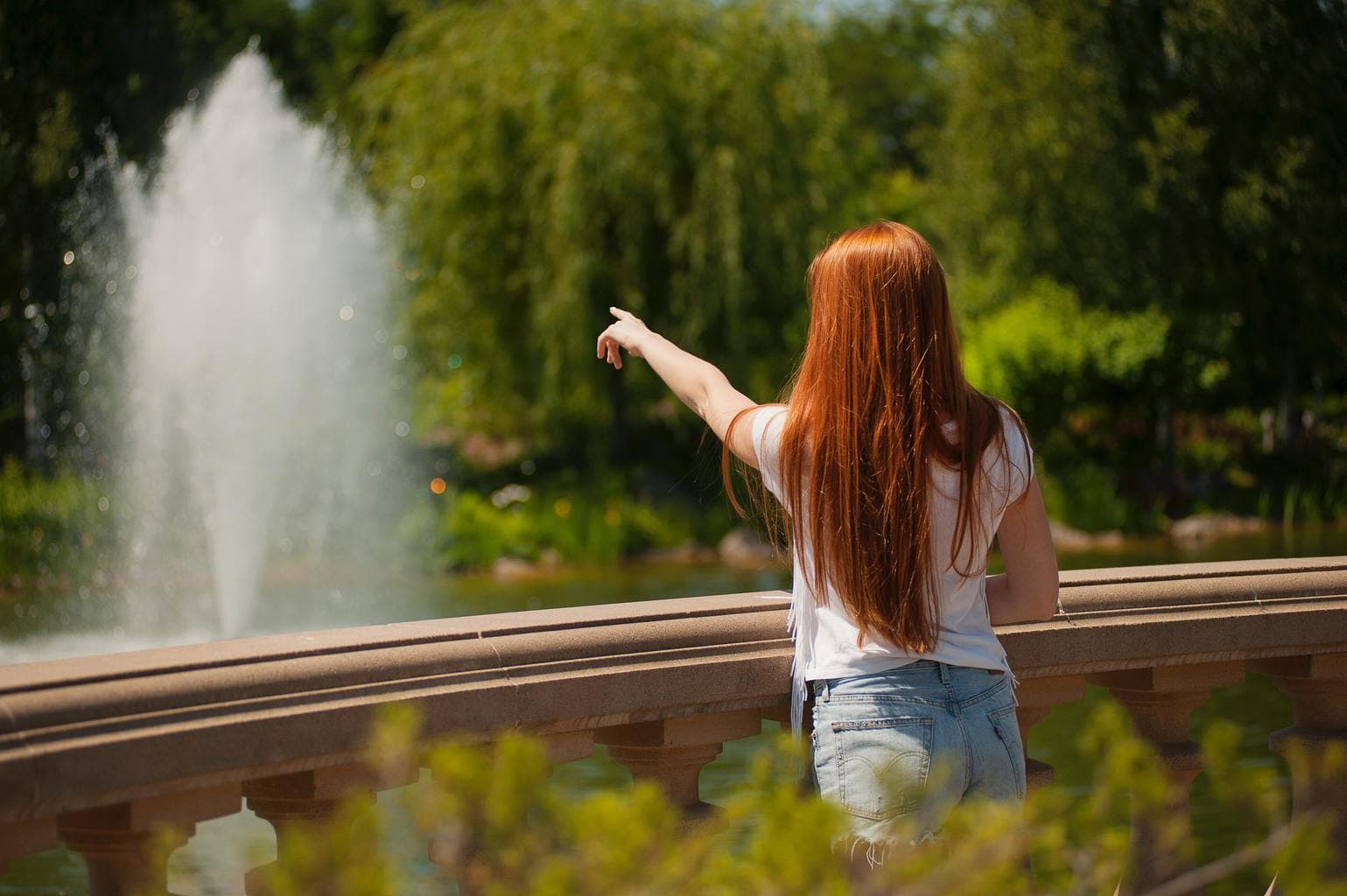 red-haired-woman-in-park