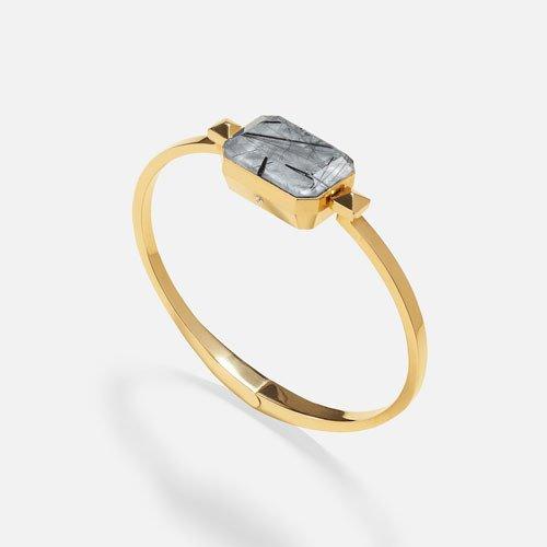 Gold bracelet with grey stone