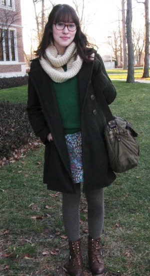 Winter street fashion at Ball State University - student wearing a sweater, knit scarf, tights, skirt, warm coat, and ankle booties