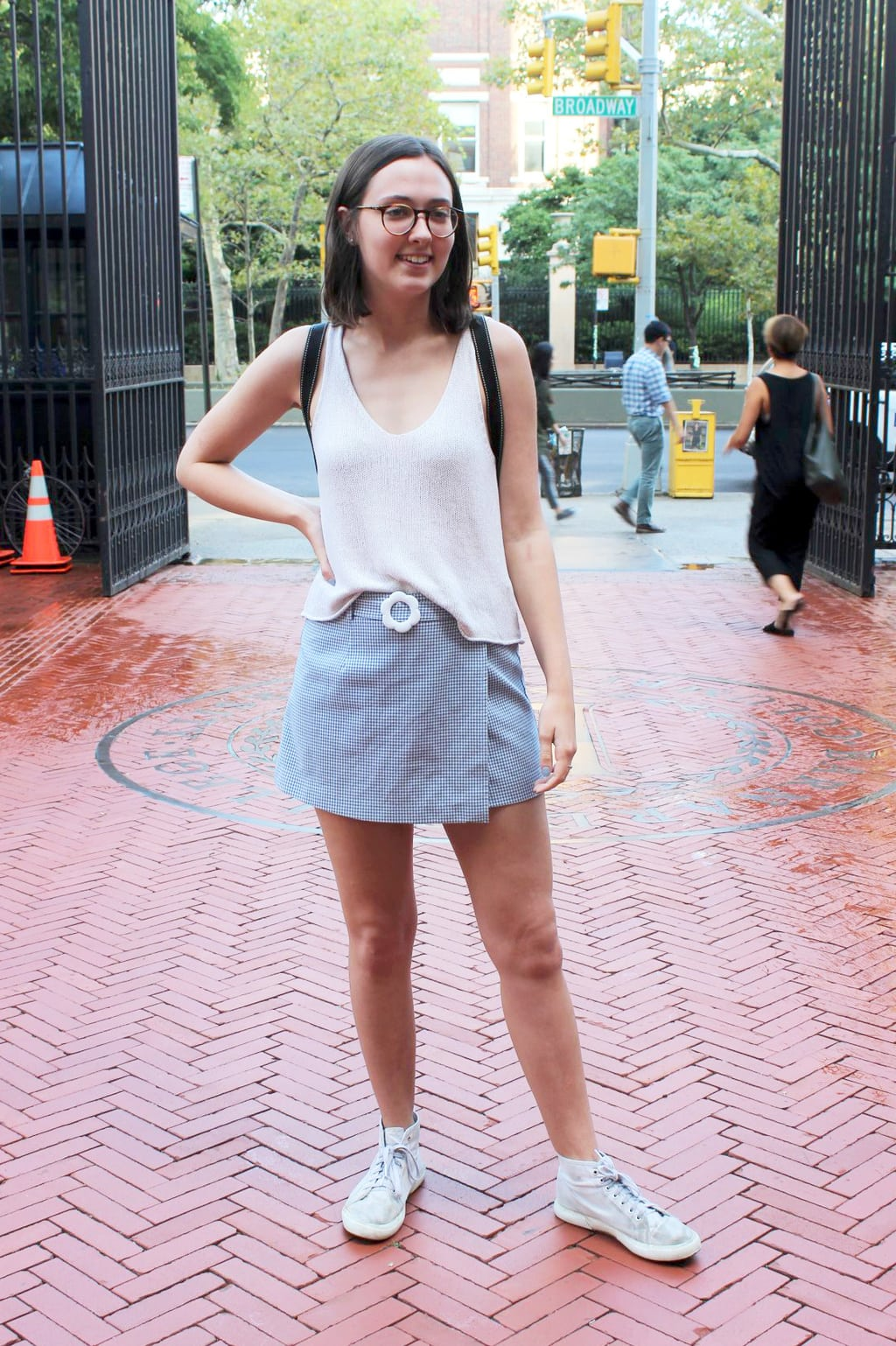 Barnard College street style: Student Julia wears a pink tank top, gingham skirt, and classic high top sneakers