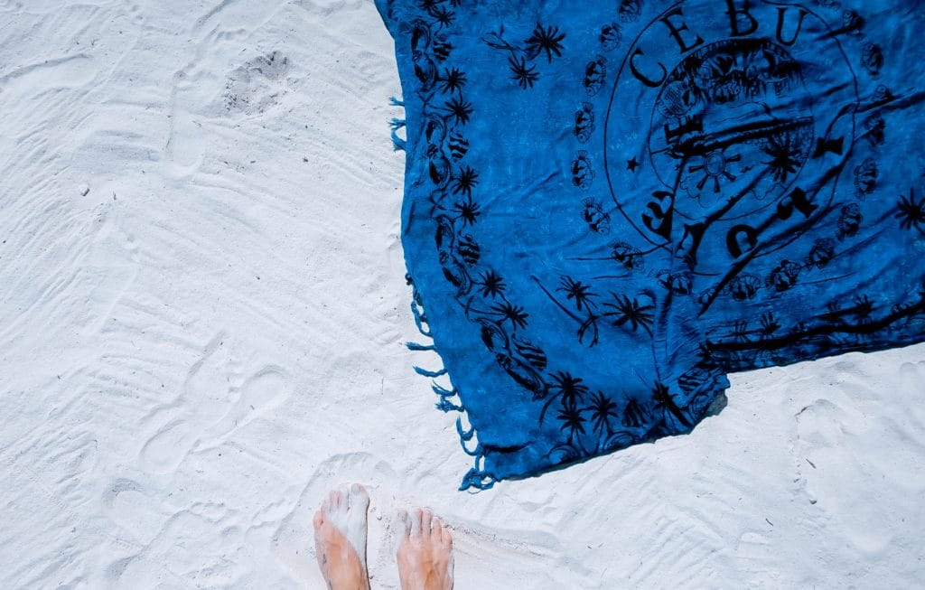 Beach blanket on the sand