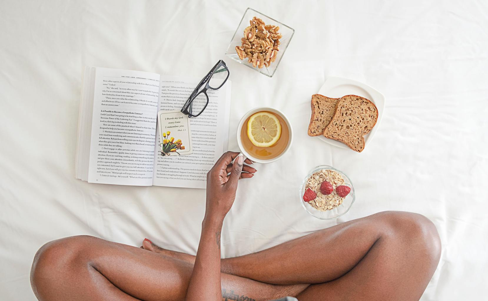 person-bed-book-food-glasses