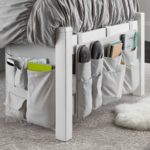 Hanging dorm bed grey canvas storage organizer with pockets.