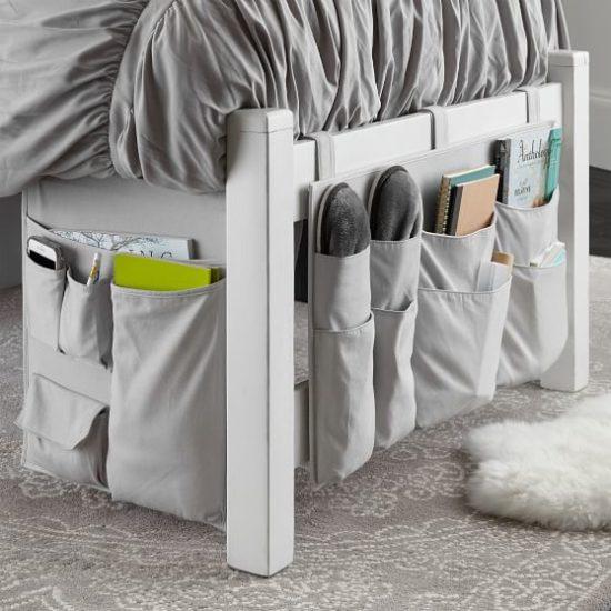 Hanging dorm bed grey canvas storage organizer with pockets.