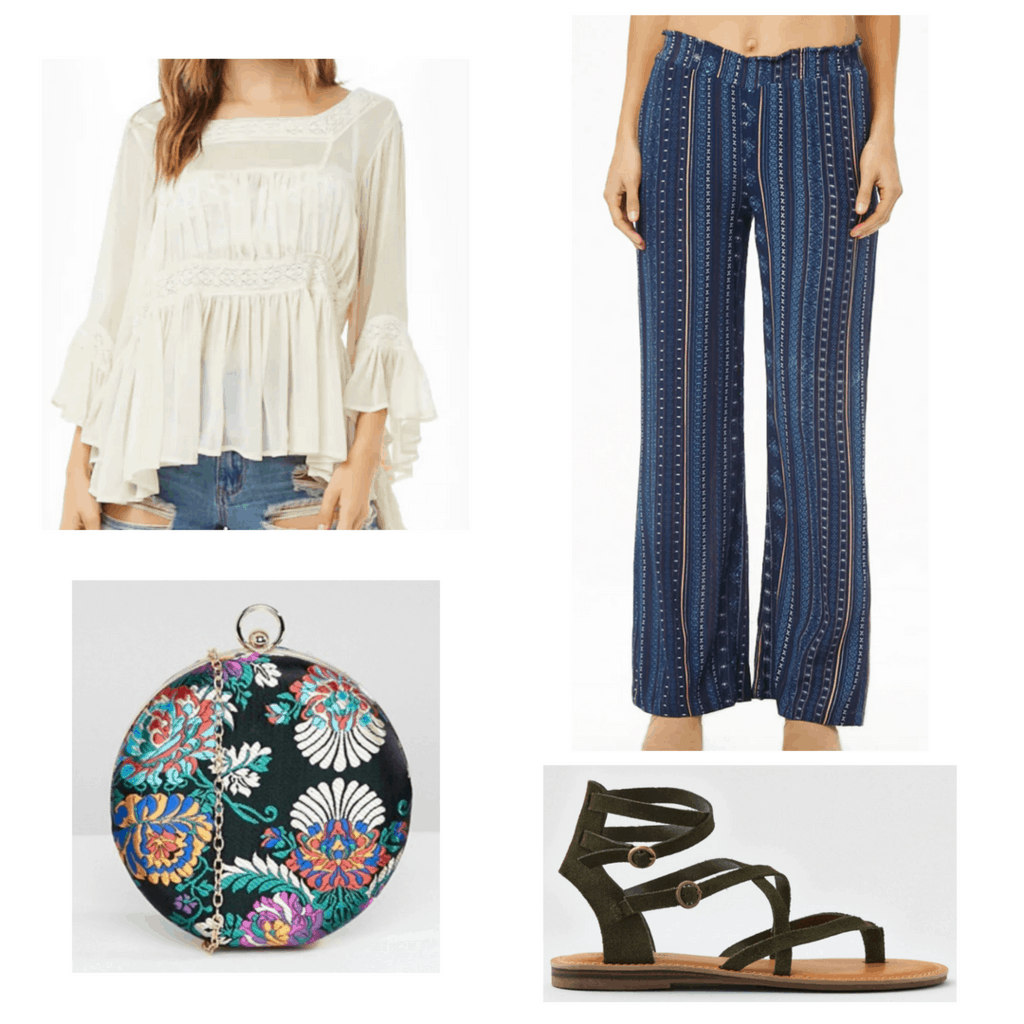 White bell sleeve top with blue wide leg pants, printed bag and green sandals