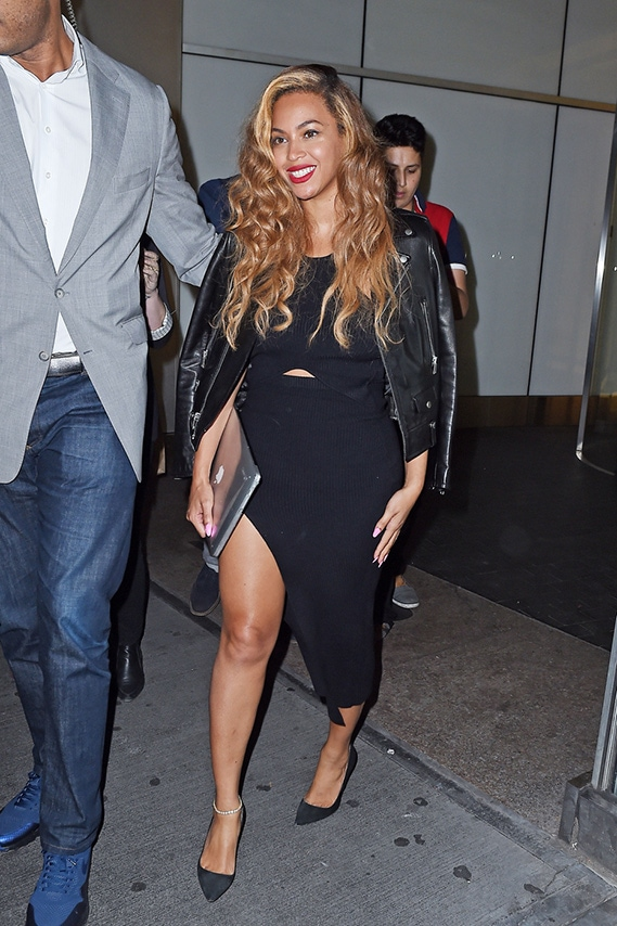 Beyonce wearing a black midi dress with slit, pointy toe pumps, and a leather jacket