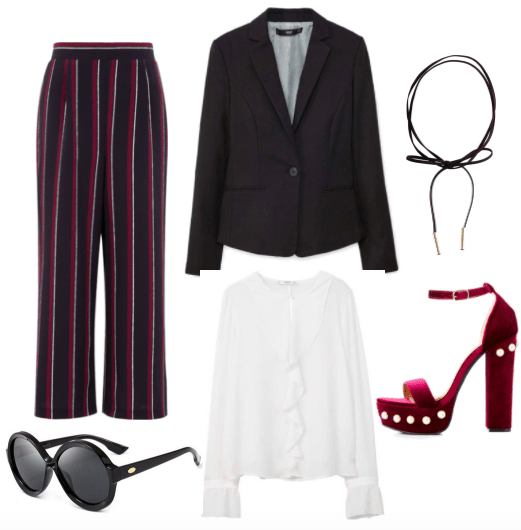 Burgundy and black vertical striped wide leg cropped trousers, a black blazer, a black bow leather choker, large black round sunglasses, a ruffled white satin blouse, and burgundy platform heels with circular gold embellishments.