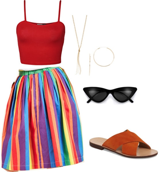 Billie Lourd birthday party outfit: Rainbow skirt paired with a red crop top and slide sandals. Accessories include a long tassel necklace, gold hoop earrings and black cat-eye sunglasses.
