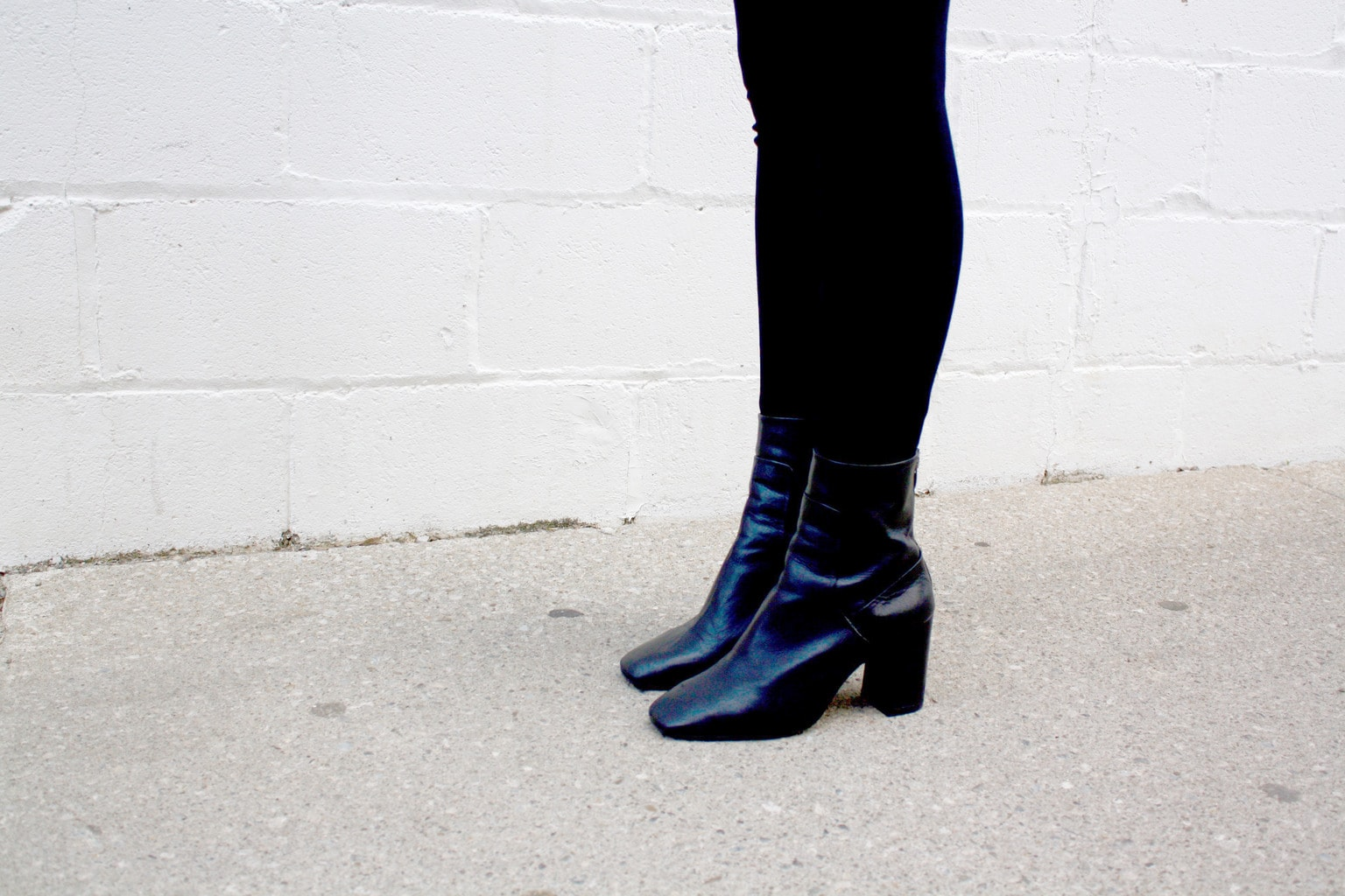 Black ankle booties on campus at Western University