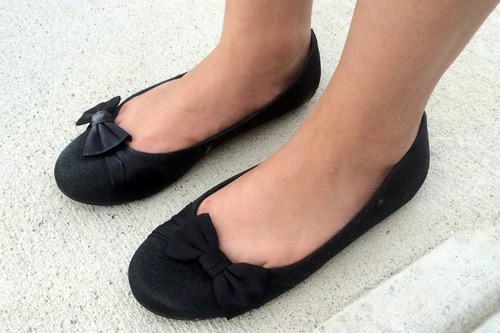 Black ballet flats with bow detailing