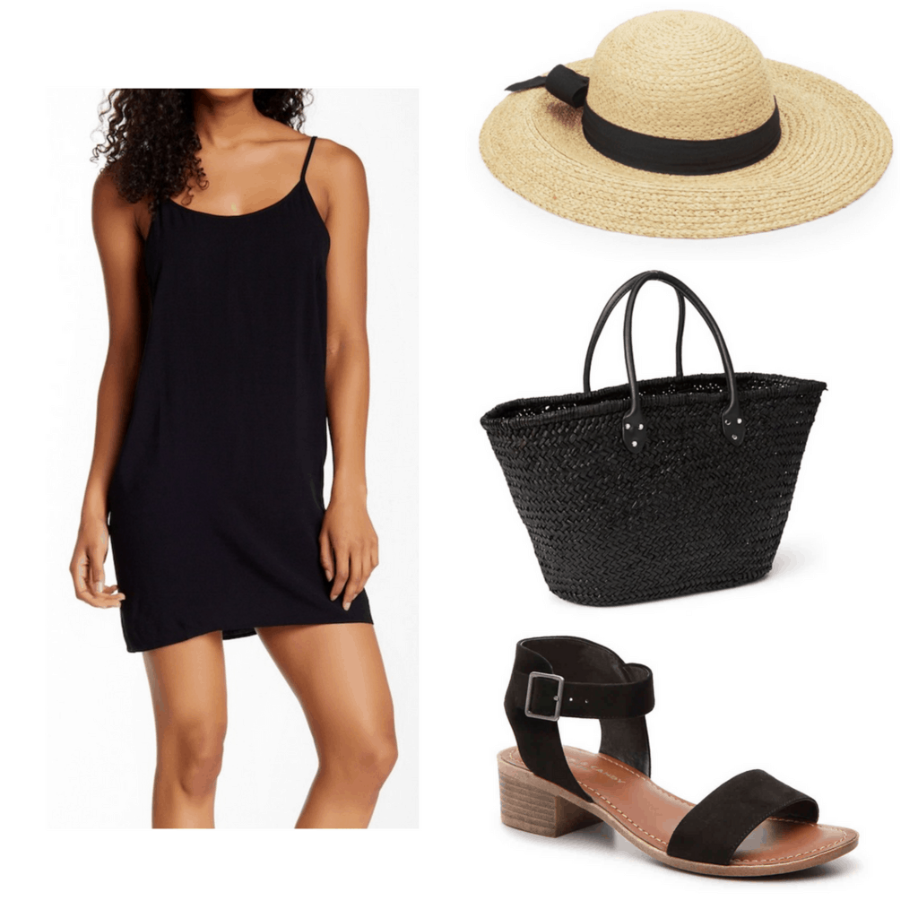 Black slip dress with black ribbon sun hat, black woven bag, and black sandals