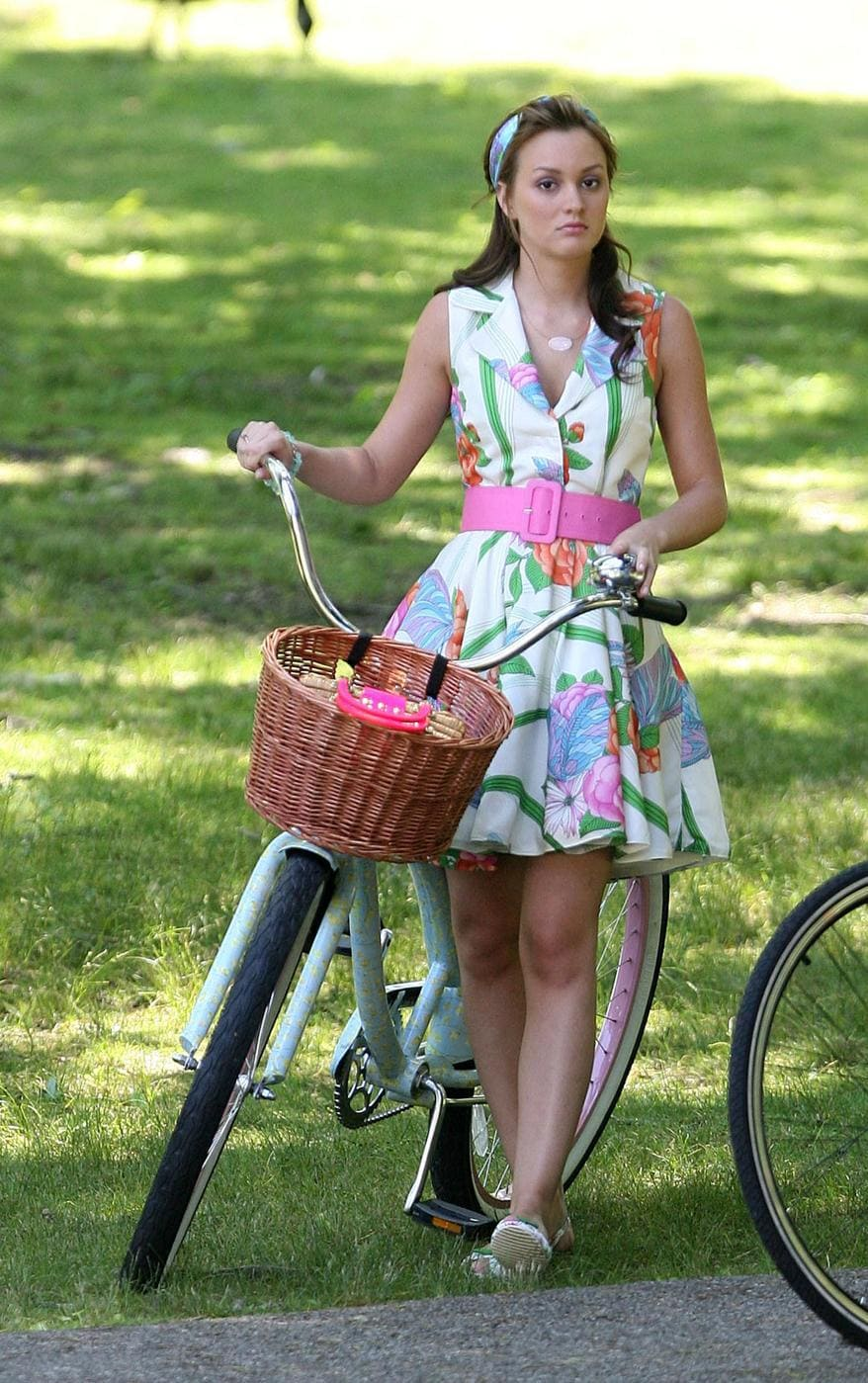 Blair Waldorf with a bike wearing a floral dress with a pink belt