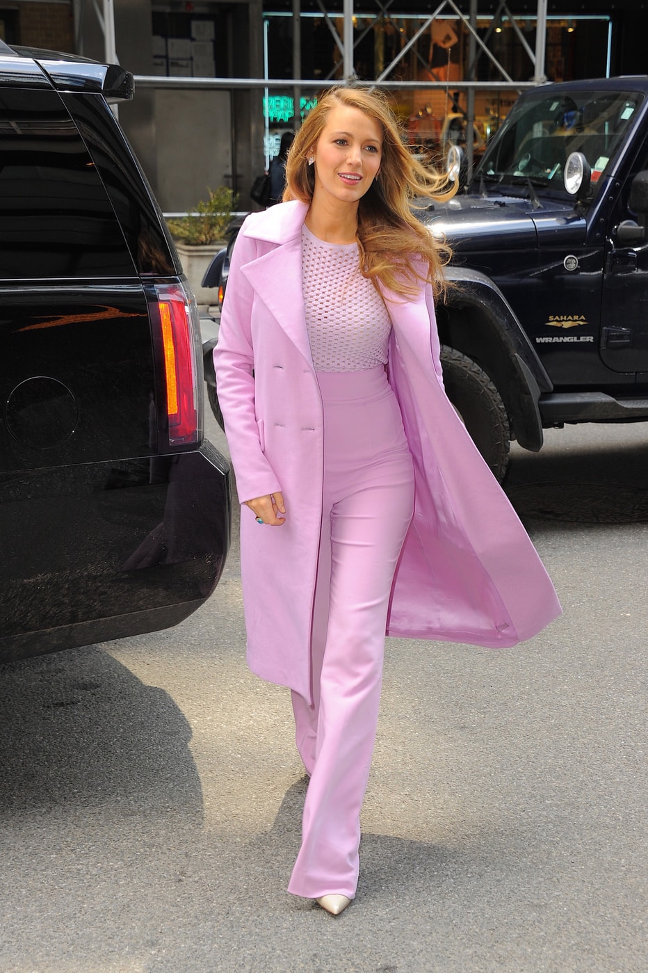 Blake Lively in bold pink attire.
