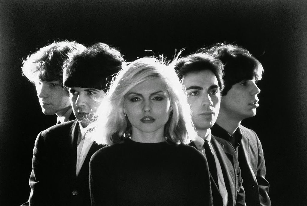 A black and white photo of the band Blondie with lead singer Debbie Harry at center
