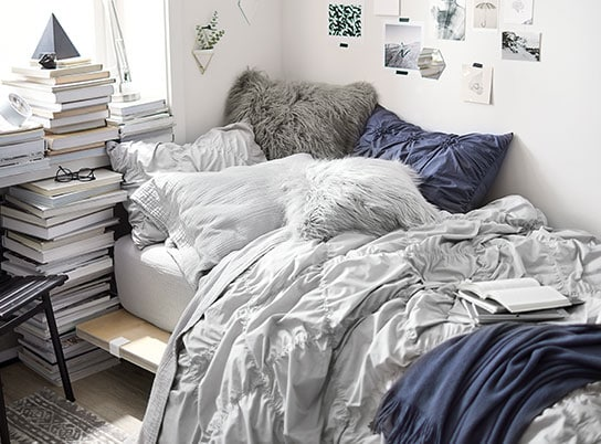 Blue, gray and white dorm room