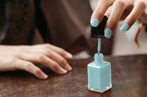 Light blue pastel nail polish