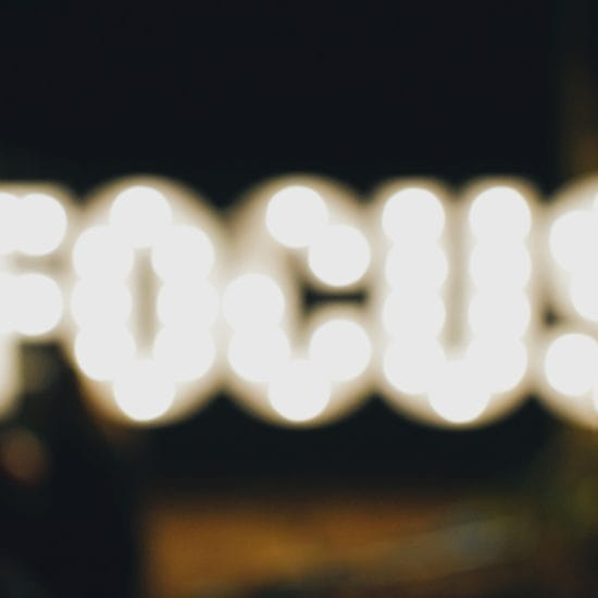 blurred lighting of the word focus
