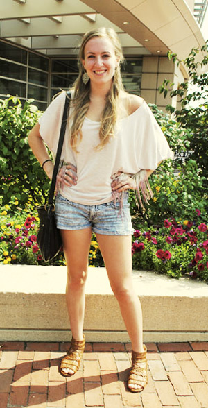 College fashionista Shannon from Boston University showing off her street style look of jean shorts, gladiator sandals, and a fringed top