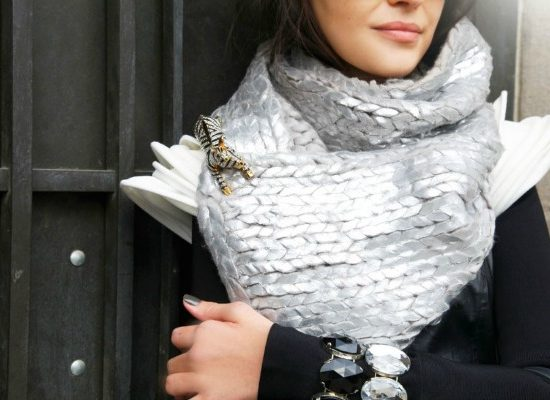 girl wearing a brooch on a scarf