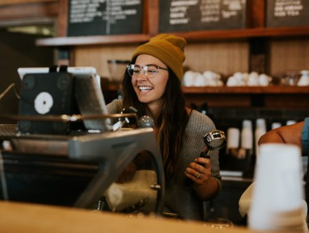 A college student working as a barista.