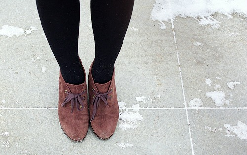 Brown ankle booties and black tights