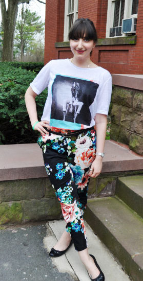 College student street style at Bucknell University: Floral pants, graphic tee, ballet flats, sideways cross necklace