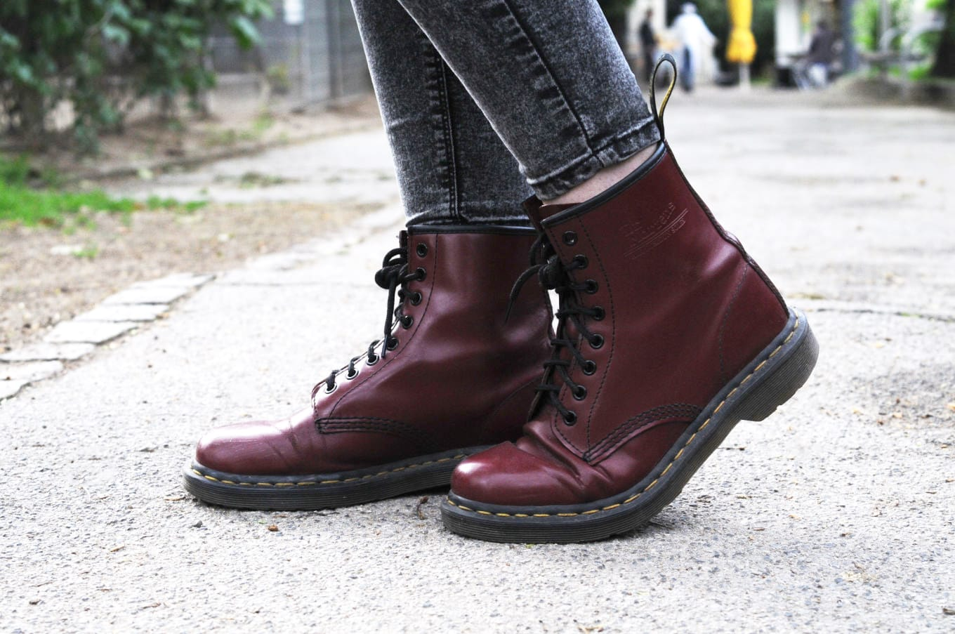 Maroon Doc Martens boots with black laces on campus